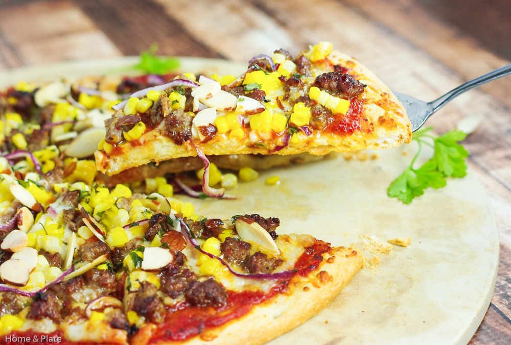 Spicy Sausage, Sweet Corn & Havarti Cheese Pizza | Home & Plate | www.homeandplate.com | Take a break from the traditional with this gourmet easy-to-make pizza.
