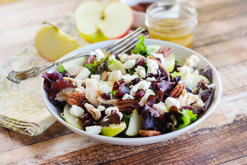 Honeycrisp Apple Pecan Salad with an Apple Cider Vinaigrette | www.homeandplate.com | This is the perfect fall salad that includes perfectly crisp apples with rotisserie chicken,pecans and crumbled goat cheese and topped with a homemade apple cider vinaigrette.