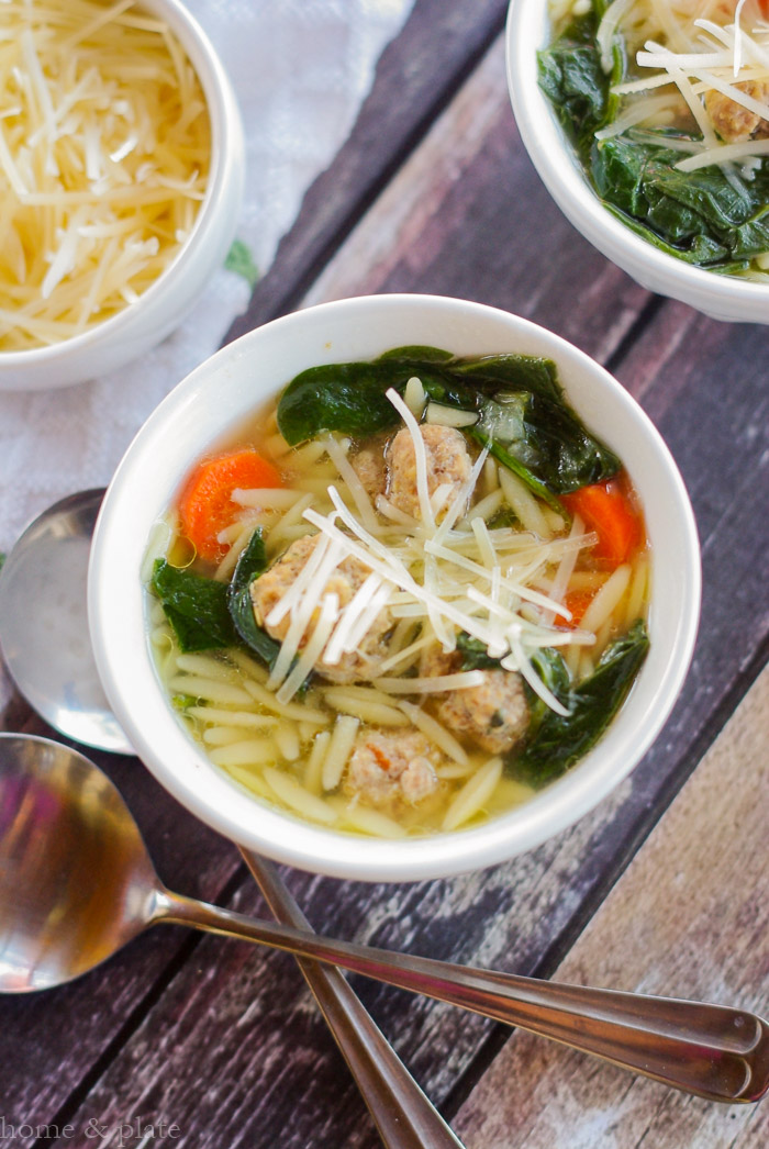 Fresh Spinach Soup with Mini Meatballs & Orzo | www.homeandplate.com | This version of Italian Wedding soup is made with tender bits of carrot, freshly wilted spinach and juicy meatball morsels with orzo pasta in a flavorful chicken broth.