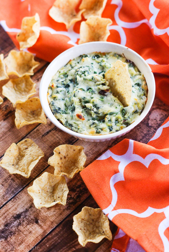 Guilty Pleasures Spinach Artichoke Dip | www.homeandplate.com | It's loaded with a blend of mozzarella, Parmesan and Muenster cheeses, tangy artichoke hearts and creamy spinach.