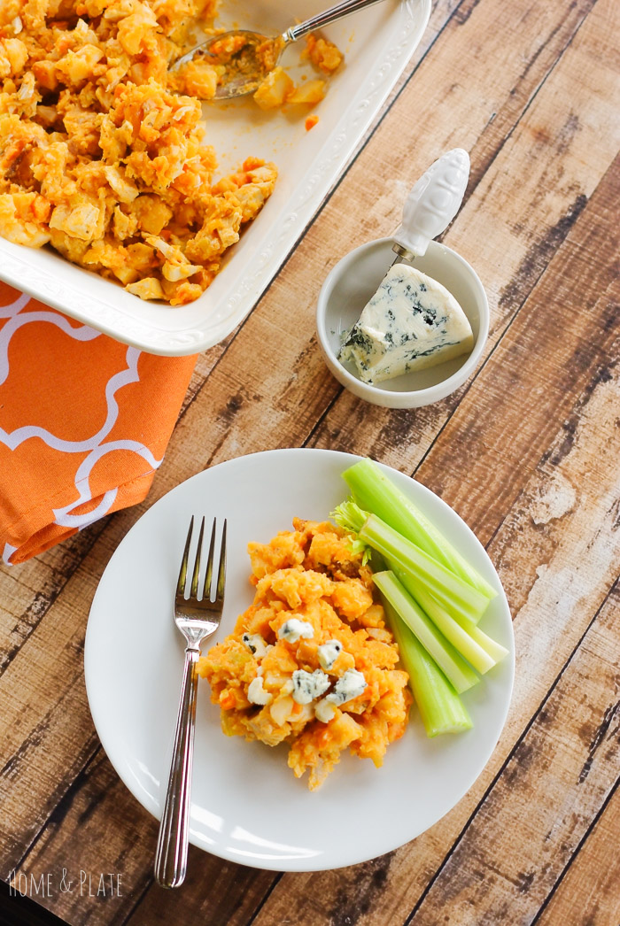Buffalo Hash Brown Chicken Casserole | www.homeandplate.com | There's nothing like comfort food and this family favorite combines cheesy potato goodness with the spicy kick of buffalo wing sauce.