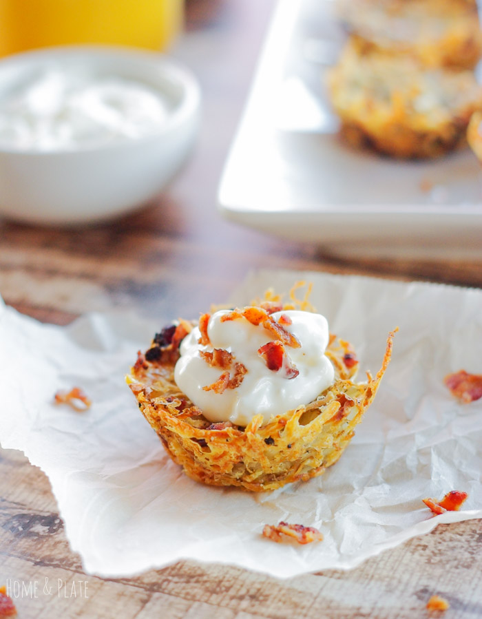 Shredded Tater Cupcakes with Gruyere & Bacon | www.homeandplate.com | This recipe incorporates sweet but slightly salty Gruyere cheese with crispy bacon with shredded hash brown potatoes.