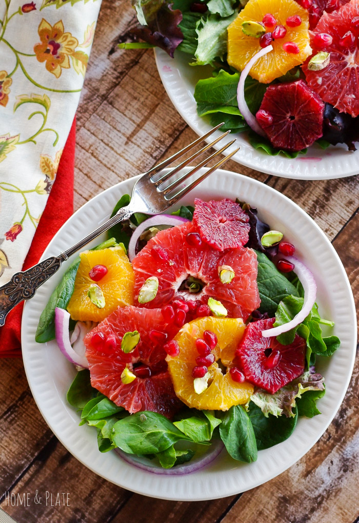 Winter Sweet Citrus Salad with Pomegranate & Pistachios | www.homeandplate.com | Celebrate Valentine's Day with your sweetheart with a colorful arrangement of citrus on a bed of greens.