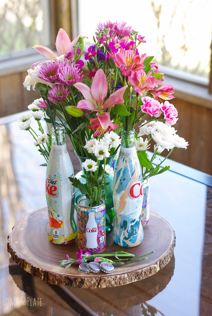 Stunning floral centerpiece featuring diet coke quot it s mine