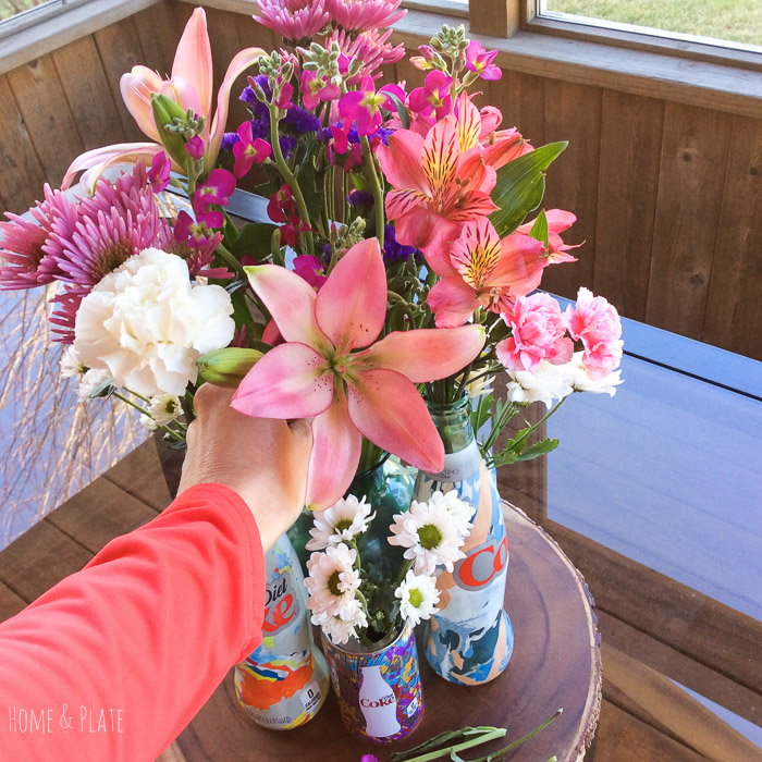 stunning-floral-centerpiece-featuring-Diet-Coke-Its-Mine-glass-bottles (21).jpg