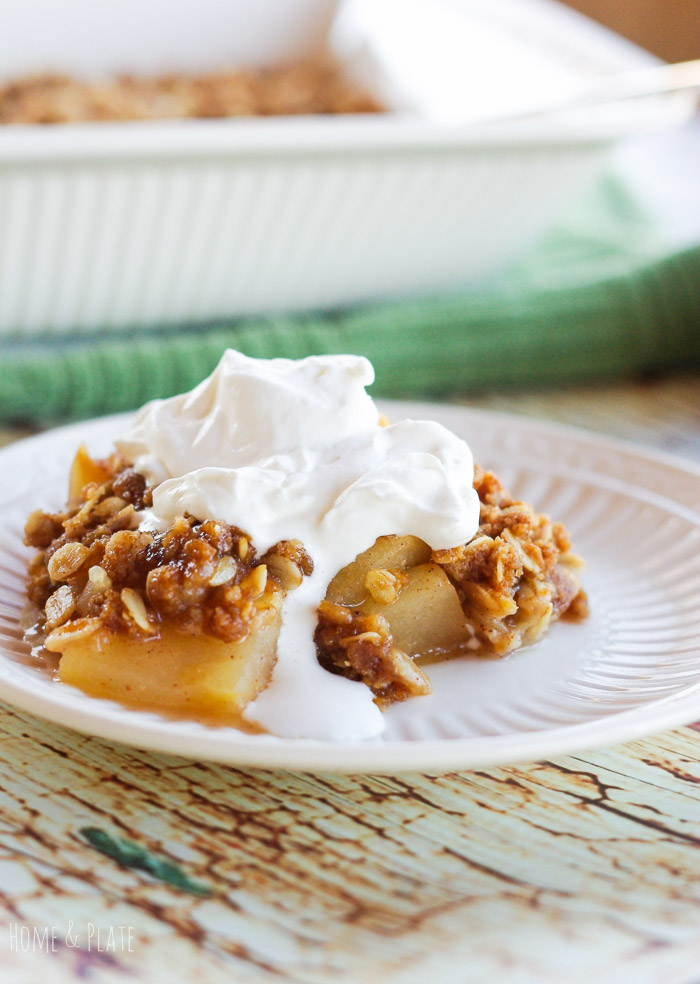 Celtic Apple Crisp with Honey Whiskey Whipped Cream | www.homeandplate.com | Turn your favorite apple crisp recipe into a grown-up version by simmering the apples in a little honey whiskey to add a little punch to this typically Irish dessert.