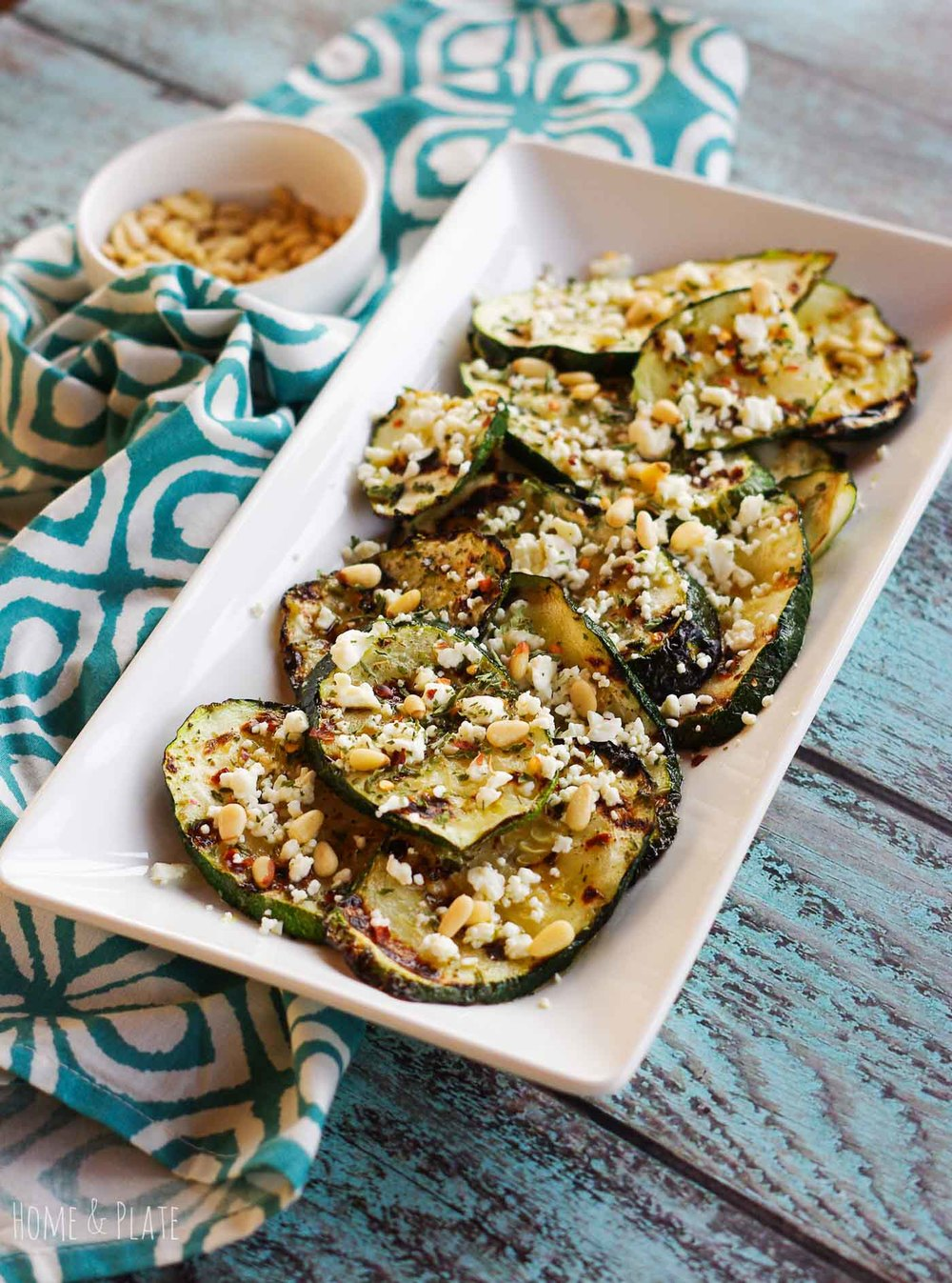 Grilled Zucchini with Feta & Pine Nuts | www.homeandplate.com | This recipe of grilled zucchini with feta and pine nuts makes grilling out easy and delicious.