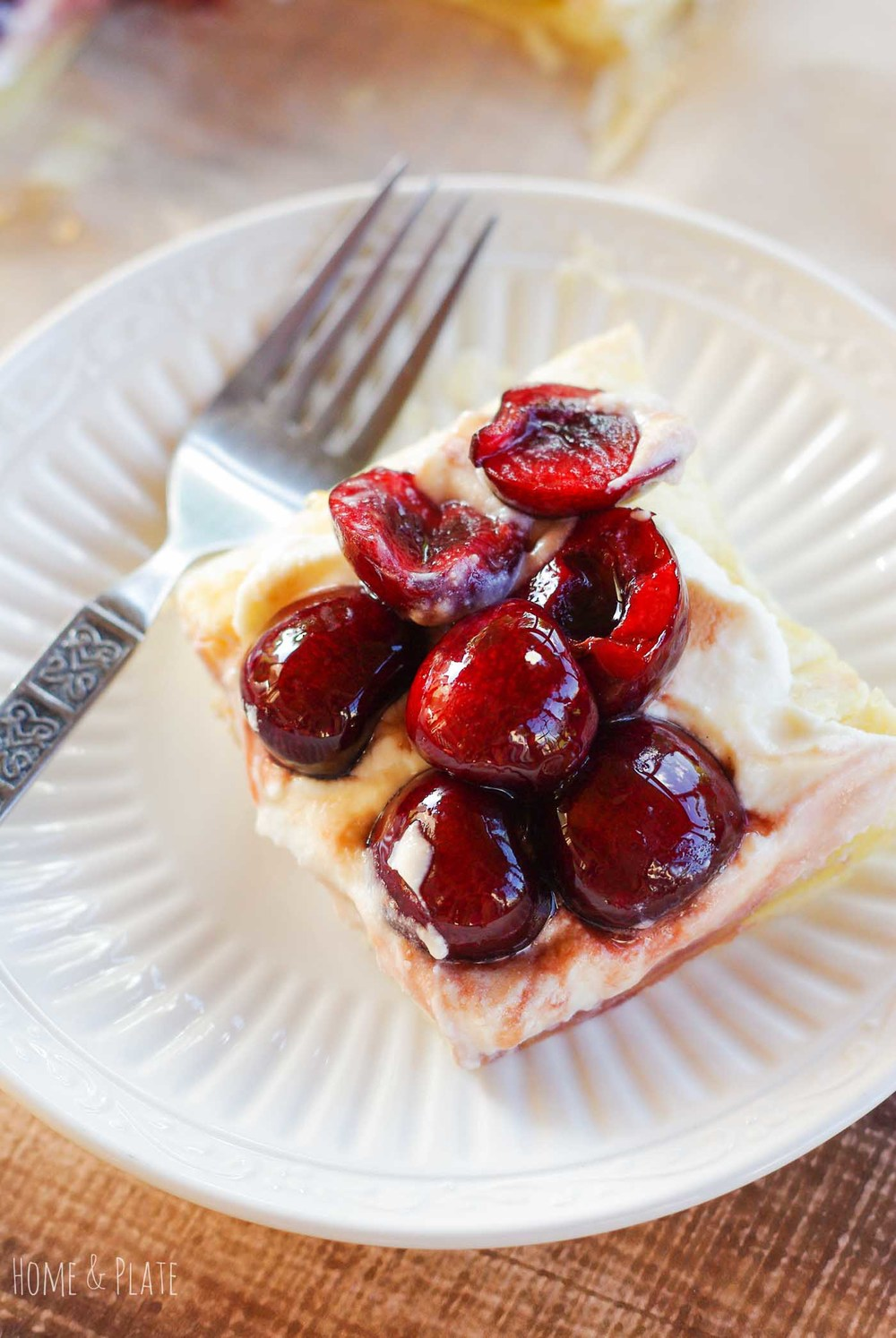 Cherry & Honey Ricotta Tart | www.homeandplate.com | Summer is the season for sweet cherries. My cherry and honey ricotta tart is the perfect dessert that is easy to make and delicious.
