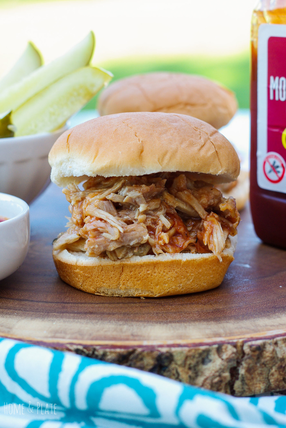 Barbecued Pulled Pork Sandwiches | www.homeandplate.com | Tender pulled pork smothered in sweet barbecue sauce piled high on a bun is the ultimate sandwich.