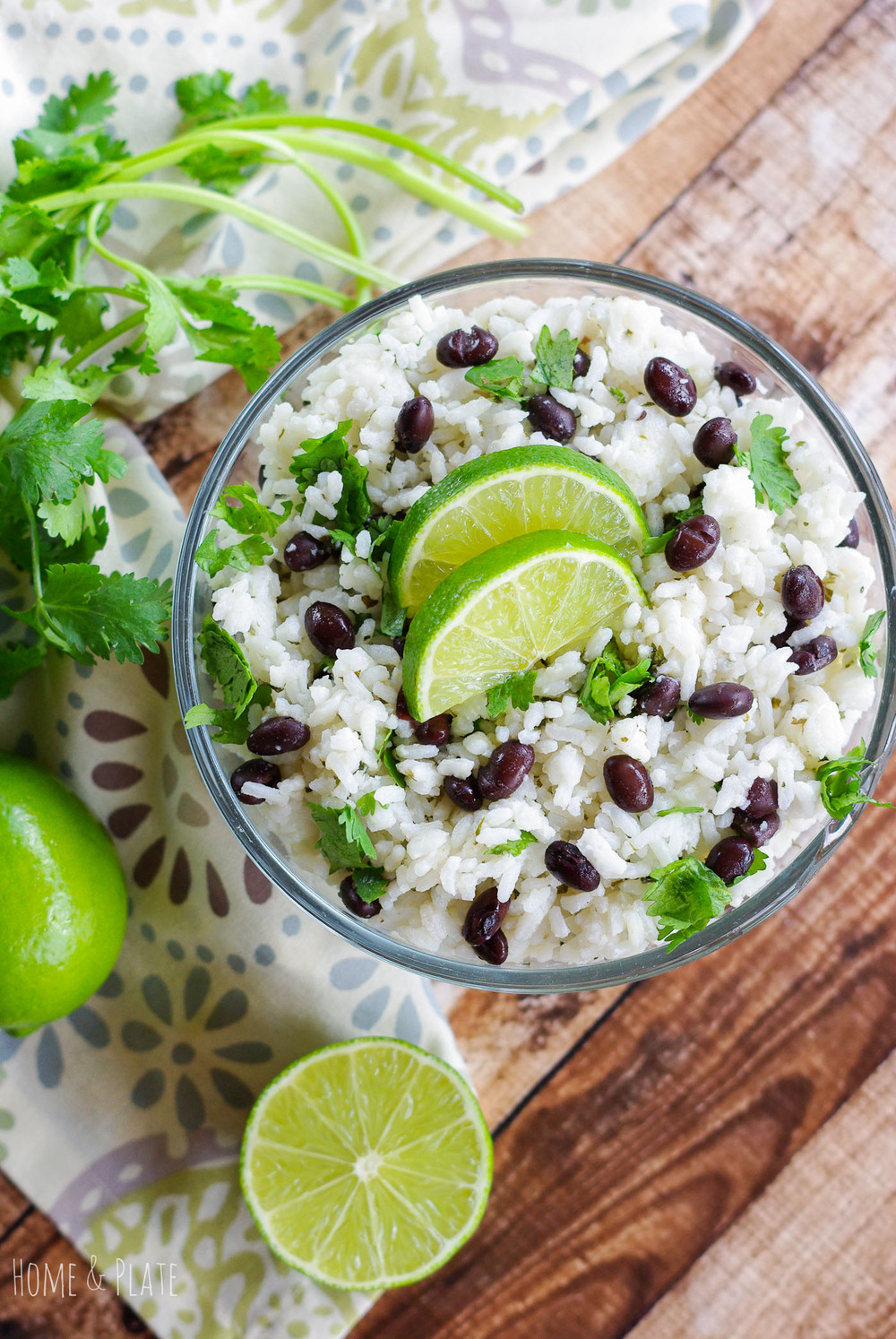 Jazz up plain jasmine rice by adding fresh squeezed lime juice, black beans and chopped cilantro.  Jasmine Rice with Fresh Lime, Black Beans & Cilantro | www.homeandplate.com | Jazz up plain jasmine rice by adding fresh squeezed lime juice, black beans and chopped cilantro.