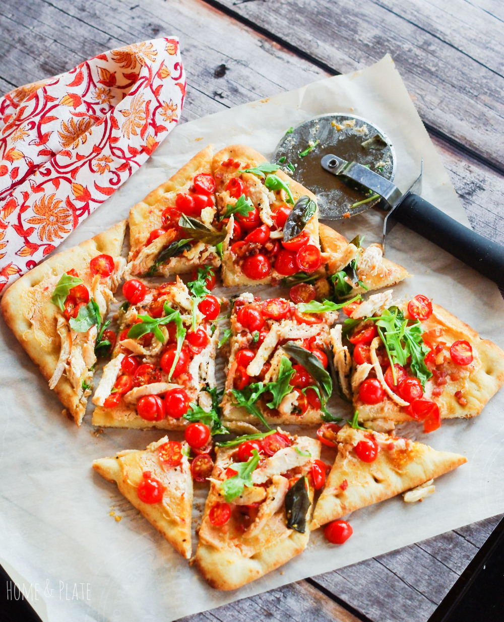 Chicken BLT Flatbread | www.homeplate.com | Enjoy summer's citrusy sweet cherry tomatoes as the highlight ingredient on this chicken BLT flatbread pizza.
