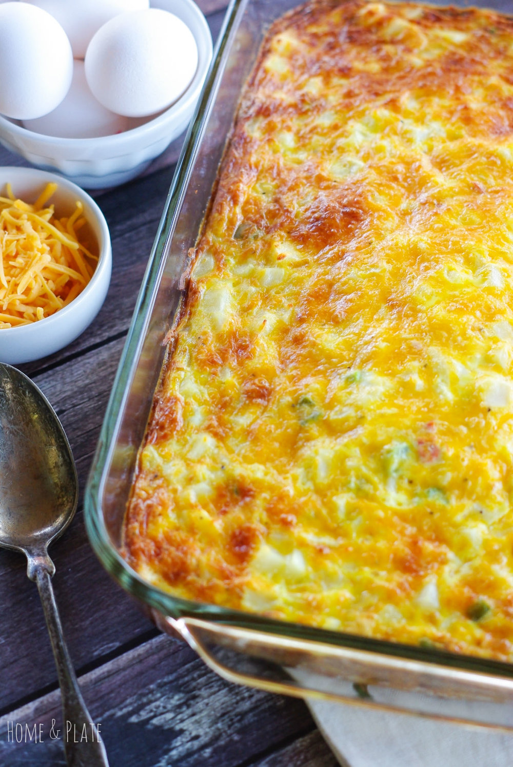 Hash Brown Egg Bake | www.homeandplate.com | It's cheesy comfort food in the morning. My hash brown egg bake is the perfect weekend or breakfast casserole to feed a group of hungry mouths.