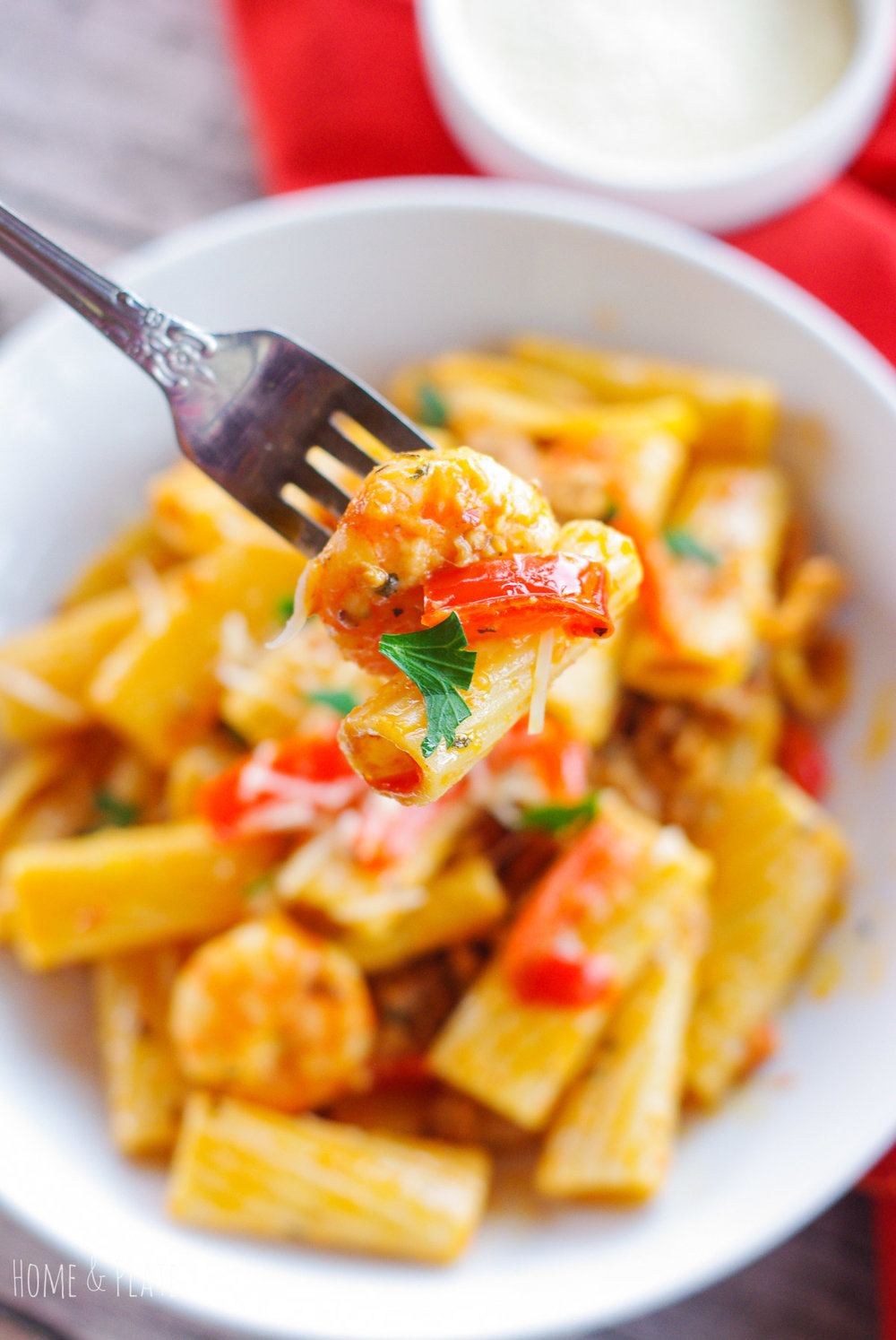 Sausage & Shrimp Rigatoni in a Spicy Parmesan Cream Sauce | www.homeandplate.com | Hot sausage and succulent shrimp marry well smothered in a spicy Parmesan cream sauce a top of bed of rigatoni.