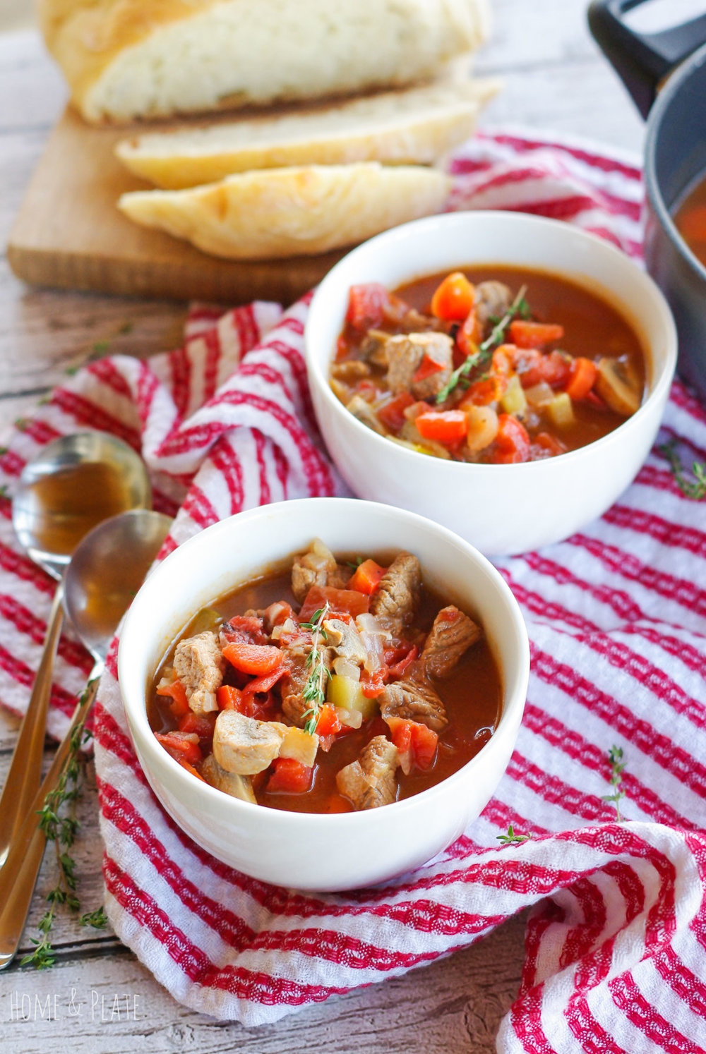 Hearty Winter Beef Stew | www.homeandplate.com | This healthy winter stew if chock full of tender beef and vegetables and can be made on the stovetop or crockpot.