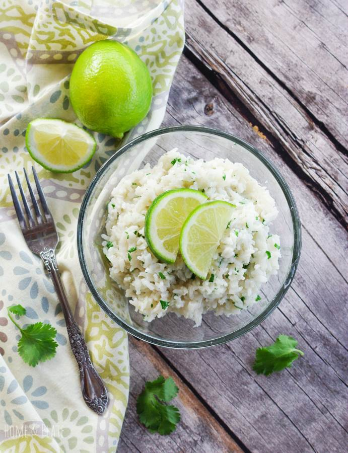 Cilantro Lime Coconut Rice | www.homeandplate.com | This easy rice recipe is cooked in under 30 minutes and flavored with coconut milk, fresh lime juice and cilantro.