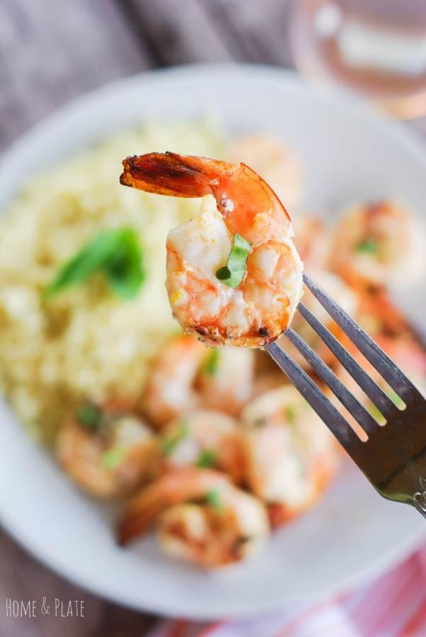 Lemon Basil Grilled Shrimp & Couscous   www.homeandplate.com   Grilled shrimp flavored with lemon zest and basil makes a delicious dinner. Serve it along side a bed of parmesan couscous.