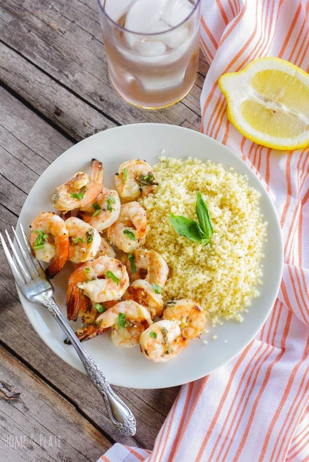 Lemon Basil Grilled Shrimp & Couscous   www.homeandplate.com  This marinated grilled shrimp and couscous is flavored with lemon zest and basil and is ready in under an hour.