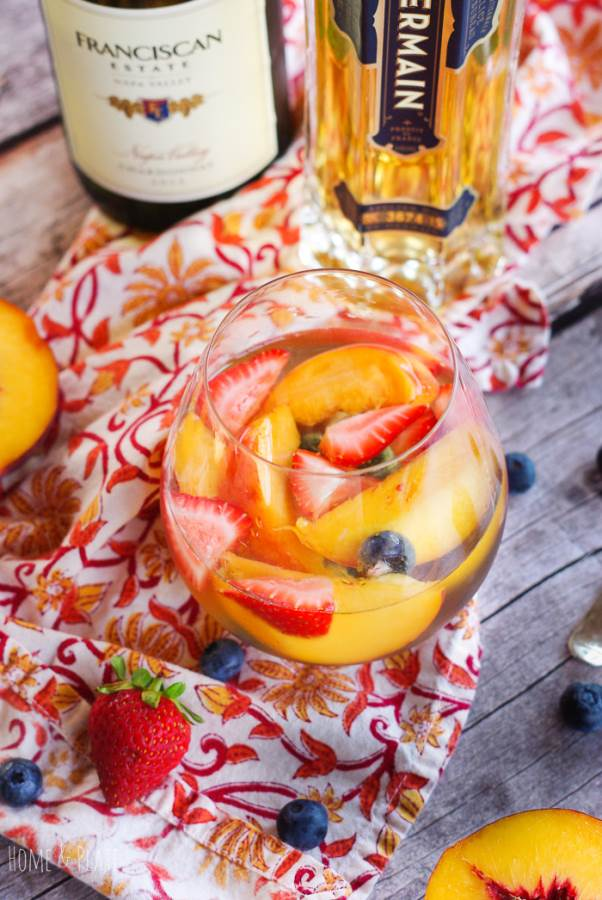 Fruity Elderflower Sangria | Summer's freshest fruits and elderflower liqueur are the stars of this fruity summer sangria spritzer. | www.homeandplate.com