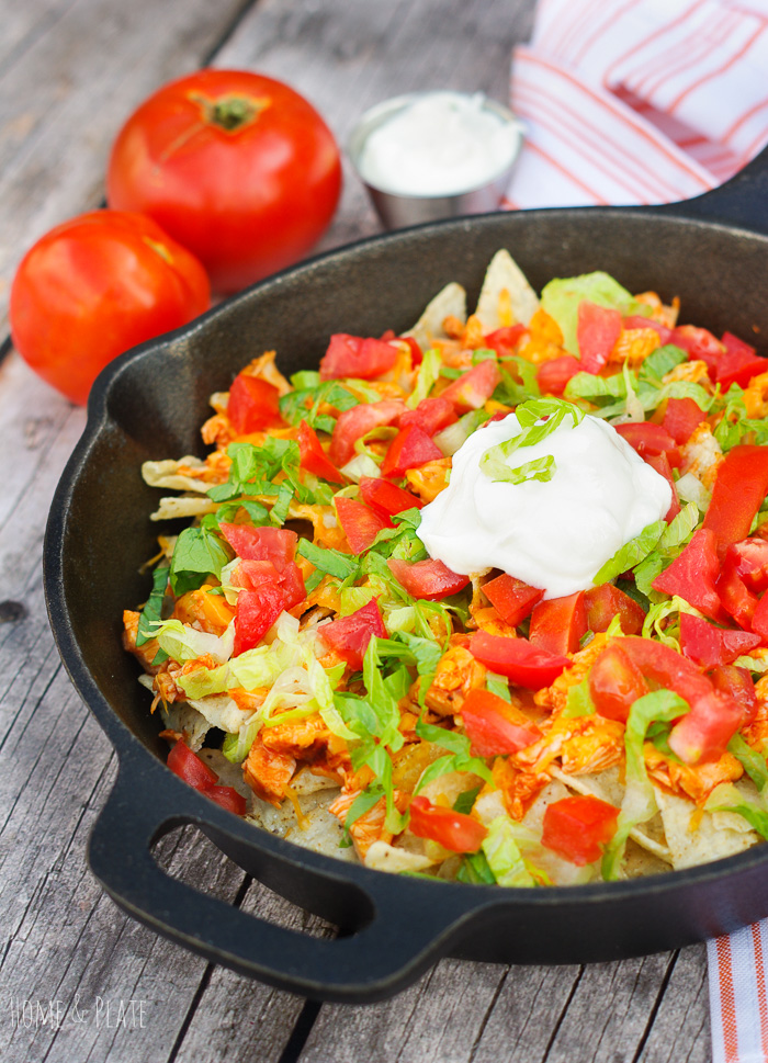 Baked Buffalo Chicken Nachos aka Nacho Ordinary Nachos | www.homeandplate.com | The perfect appetizer to spice up you tailgate or sporting event get together.