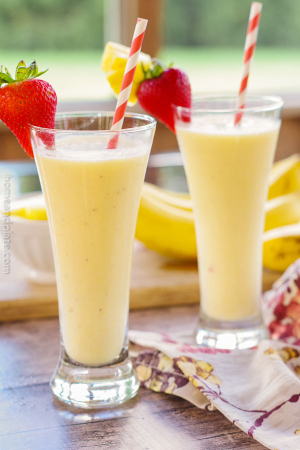 Pineapple Orange Creamsicle Milkshake | www.homeandplate.com | Sip on a milkshake that combines the tropical taste of freshly cut pineapple and banana with a novelty creamsicle popsicle.