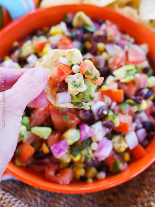 Pico de Gallo - Salsa Fresca | Homegrown tomatoes, sweet corn kernels, black beans, avocado, cilantro and lime juice is all you need to make the freshest salsa. This pico de gallo - salsa fresca - taste great with chips and on all your favorite Mexican dishes.