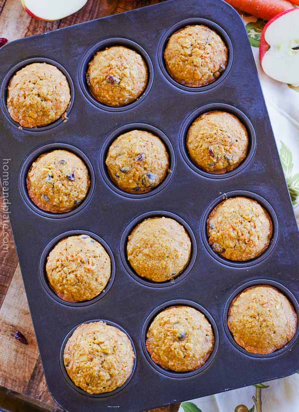 Apple Carrot Oatmeal Muffins   Apple carrot oatmeal muffins {a.k.a. morning glory muffins} feature whole wheat goodness to start your day.   www.homeandplate.com