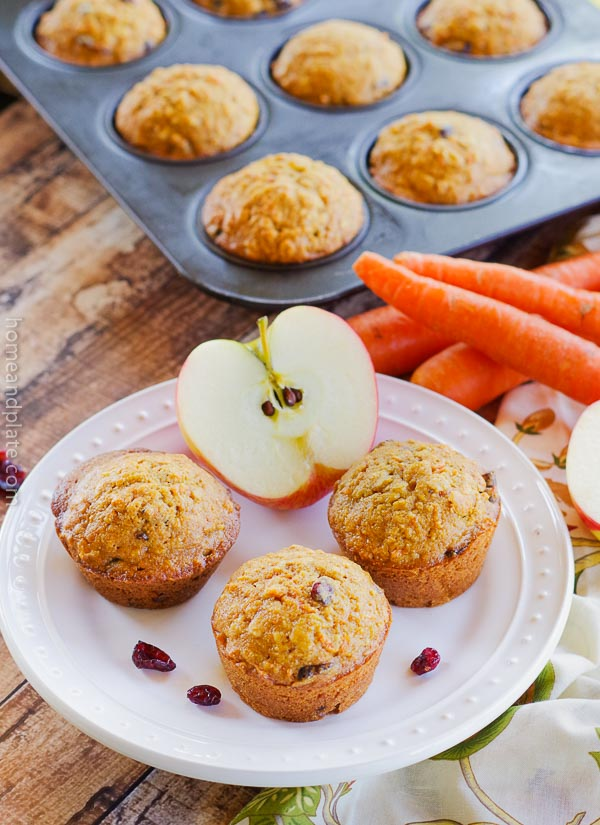 Apple Carrot Oatmeal Muffins   tart your day with a plate of apple carrot oatmeal muffins {a.k.a. morning glory muffins} which feature whole wheat goodness. www.homeandplate.com