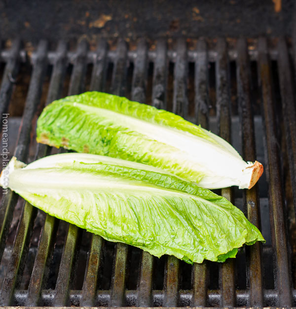Skillet Grilled Romaine Hearts with Homemade Caesar Dressing | Romaine hearts take on a smokey flavor when grilled outside.