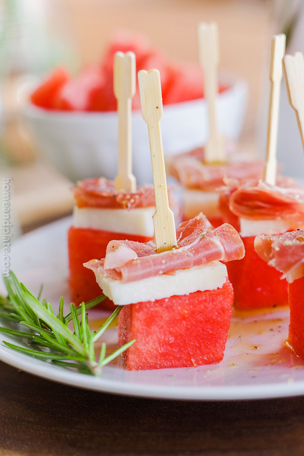 Watermelon Skewers with Prosciutto & Pecorino Romano | Sweet bites of watermelon paired with salty Pecorino Romano and meaty prosciutto makes for a simple yet bold appetizer. #watermelonskewers #watermelonappetizer #watermelon