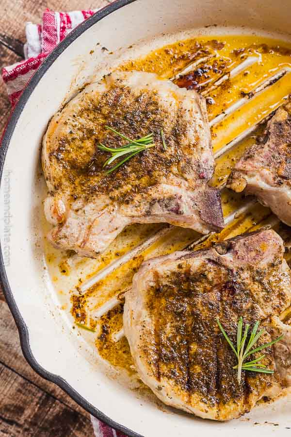 Ancho Chile Pork Chops | Juicy and tender pork loin chops rubbed in ancho chile powder are seared on the stovetop and finished in the oven in under 30 minute.