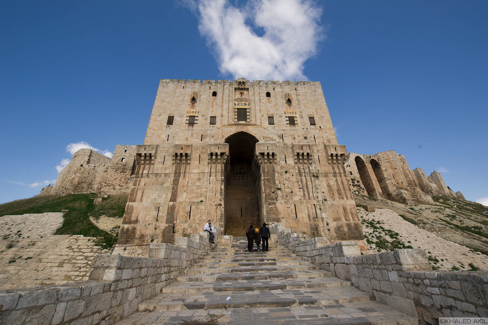 The Citadel of Aleppo is a large medieval fortified palace in the centre of the old city of Aleppo, northern Syria. It is considered to be one of the oldest and largest castles in the world.
