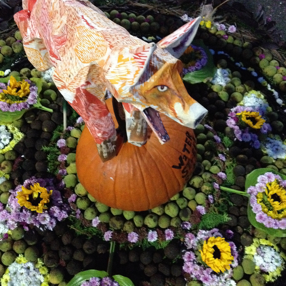 Water Street Studio Scarecrow entry with Kimberly Fredricks' papier-mâché fox and floral carpet design.