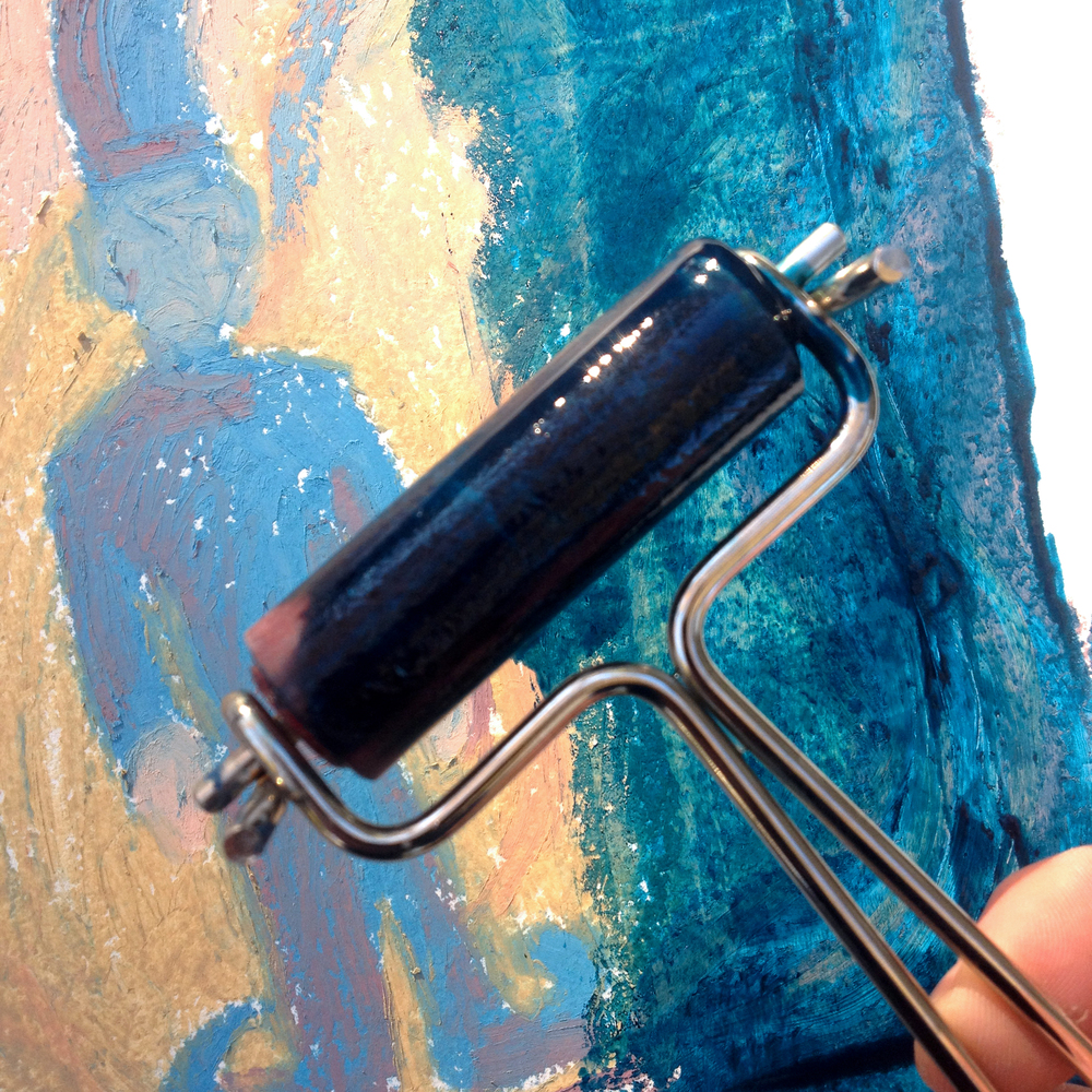 Use the brayer to apply a thin, diluted coat of etching ink over your oil pastel field drawing.