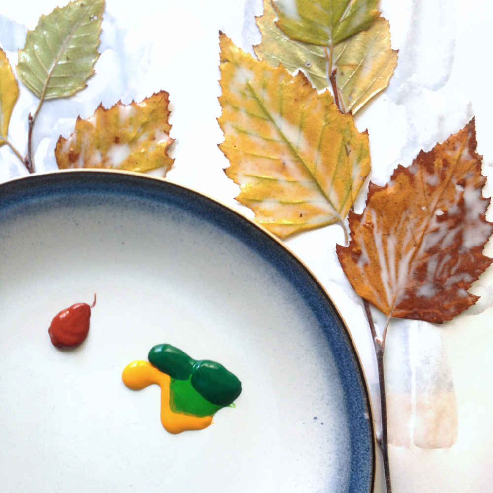 Mix the colors on a water-proof surface like a glazed ceramic plate.