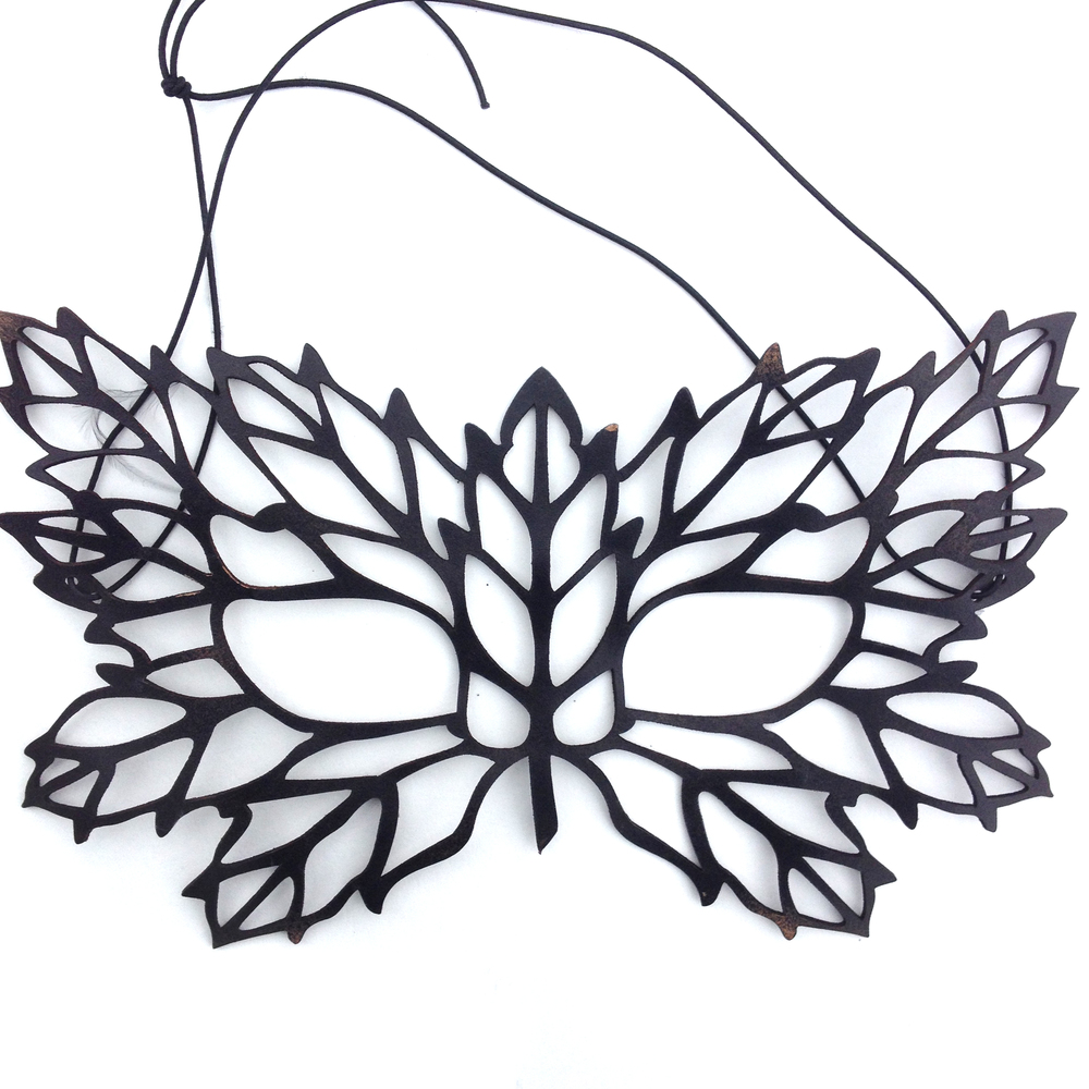 Dyed black leather cut to resemble intricate leaf filigree.