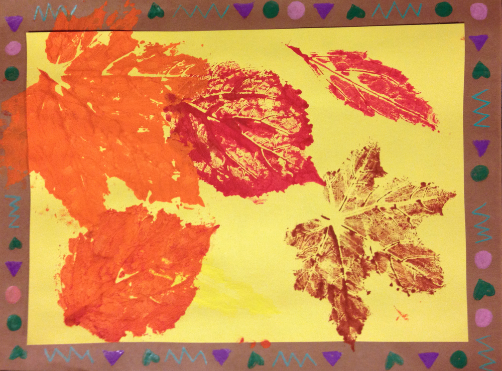 Students chose elements and colors for their pattern and used it as a border around their print. These leaves were pressed onto a yellow paper.