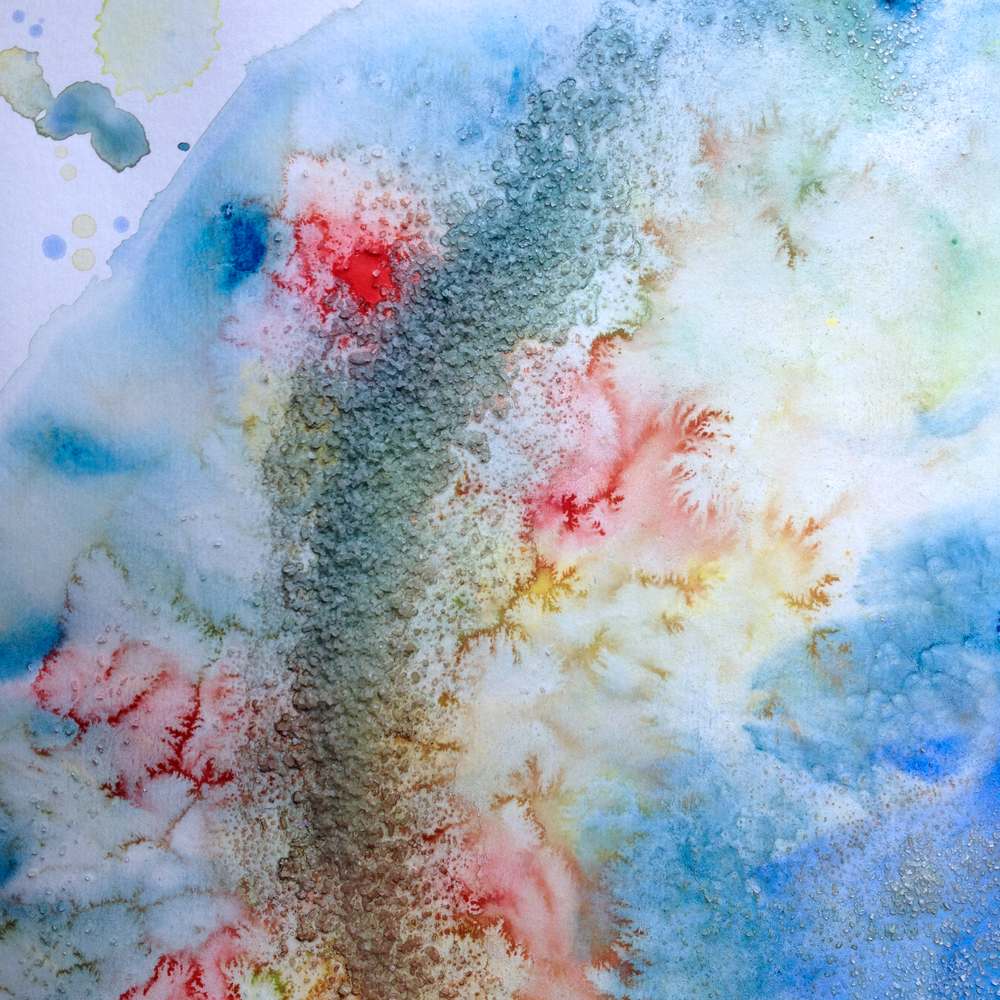 Toss salt atop the wet paper and pigment.