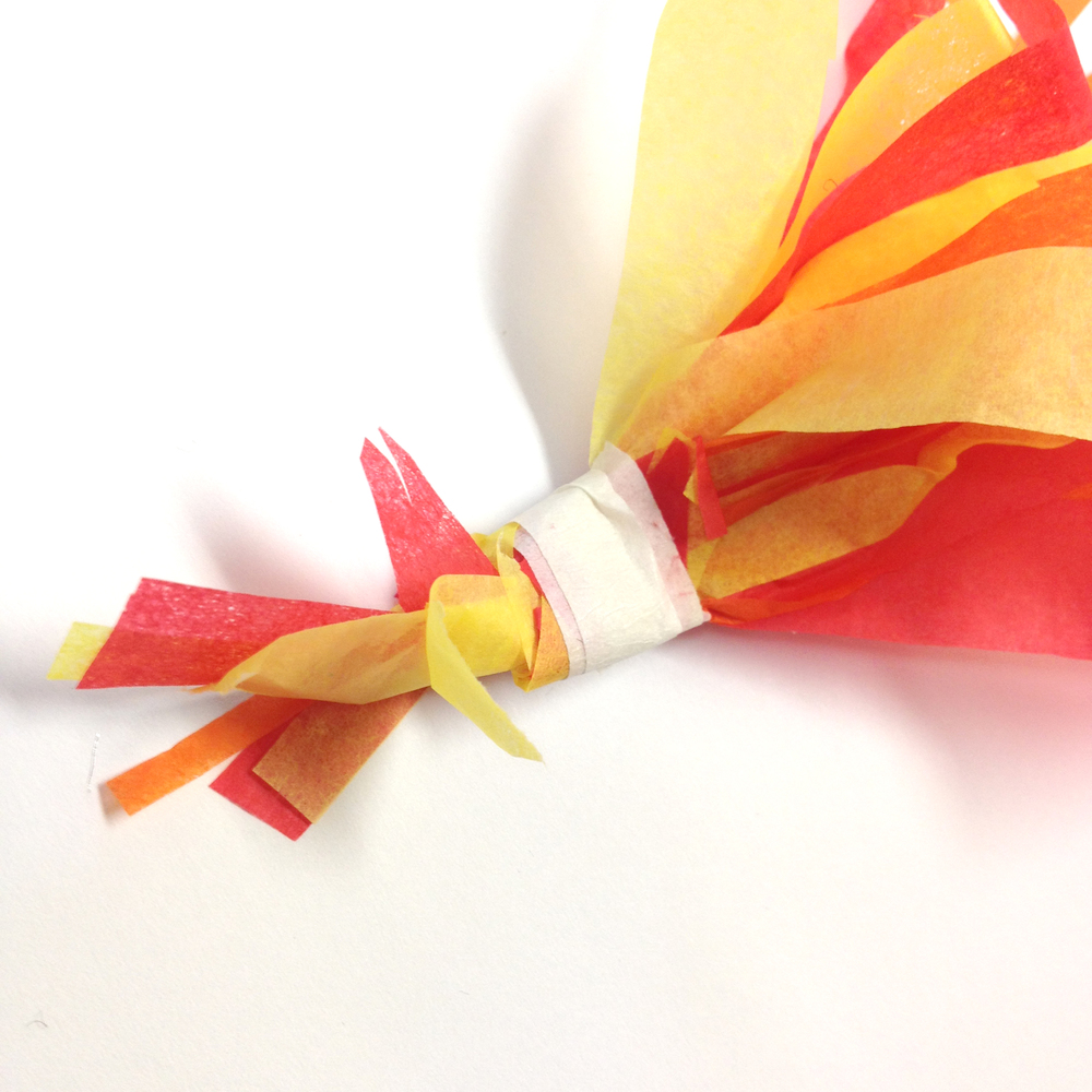 Tie the fires at one end and attach them inside the rocket.