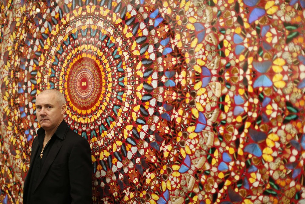 Damien Hirst with spinning mandalas and stained glassed window arrangements.