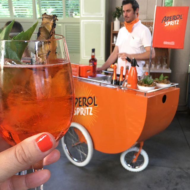 What a way to spend the solstice! Scroll through for pics of the @aperolusa #summersolspritz party with a #loveandvictory pop up! 🧡🧡 (and how about that Spritz cart?!?) #aperolspritz #spritzbreak #spritzoclock