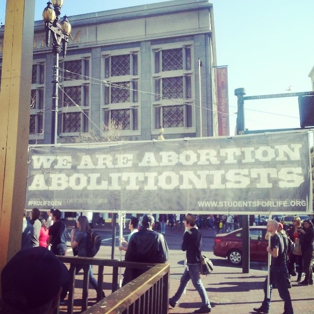 "Then these donkey butts walk by chanting with a big banner for all of us who can't read that they are ""abortion abolitionist"""
