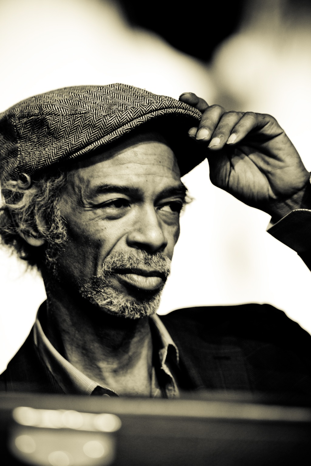 "Today marks the born day of an American born icon, literary genius, and Spoken Word great, Gil Scott Heron.    Gil Scott Heron is my foremost artistic father and inspiration. Having the opportunity to perform as an opening act for him was and will remain one of the greatest and most humbling experiences of my life.       As a teen, listening to his work did for me what my teachers, government, and community failed to fully do; be honest about our plight and give indictment to the authors of my poverty. Gil as one man represented a million men and women. That lost but (barely) in tact tribe of ghetto intellectuals who could hold their own at any Ivy League institution but may have also been addicts, fiends, and or incarcerated.       My father has battled with addiction my entire life- something that was kept from me until my late teens. His absence and abusive behavior never made sense to me until his drug addiction was revealed to me. I reflect on Brother Gil's work and realize that my father is ""Pieces of a Man"", ""Home is Where the Hatred Is"", and the like.       This epitomizes what Gil offered us. Through his self – sacrificing and offering such raw vulnerability through his personal stories he helped us understand ourselves. Through his shame, smart assness, resistance speech, and triumph we found an ally and a reason to keep on keepin' on.       Gil Scott Heron is to be loved, regarded, and honored in the same vain as Malcolm X, Tupac Shakur, Howard Zinn, Martin Luther King, and Paulo Coelho.     One Perfect Love,   ise m. lyfe"