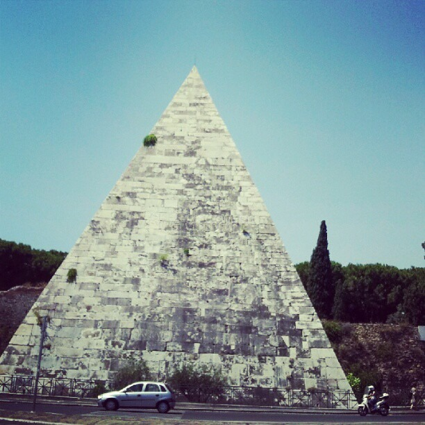 Here in Rome, uncomparable to those in Egypt, but impressive nonetheless are pyramids! The train station near my hotel is called pyramaide due to its close proximity to this one. (Taken with  Instagram )