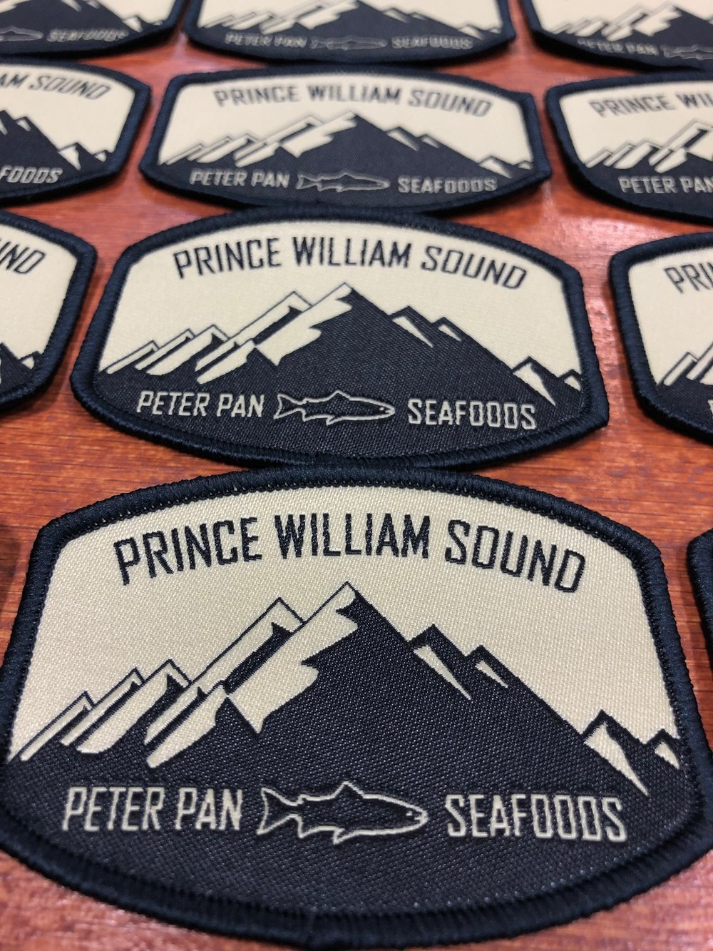 logounltd_laser_etching_embroidery_screen_printing_apparel_uniform_custom_tshirts_kirkland_bellevue_seattle_redmond_woodinville_branded_merchandise_promotional_products_logo_unltd_woven_patches_peter_pan_seafoods  (2).jpg