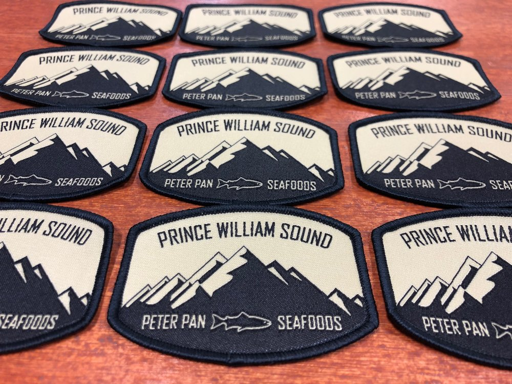 logounltd_laser_etching_embroidery_screen_printing_apparel_uniform_custom_tshirts_kirkland_bellevue_seattle_redmond_woodinville_branded_merchandise_promotional_products_logo_unltd_woven_patches_peter_pan_seafoods .jpg