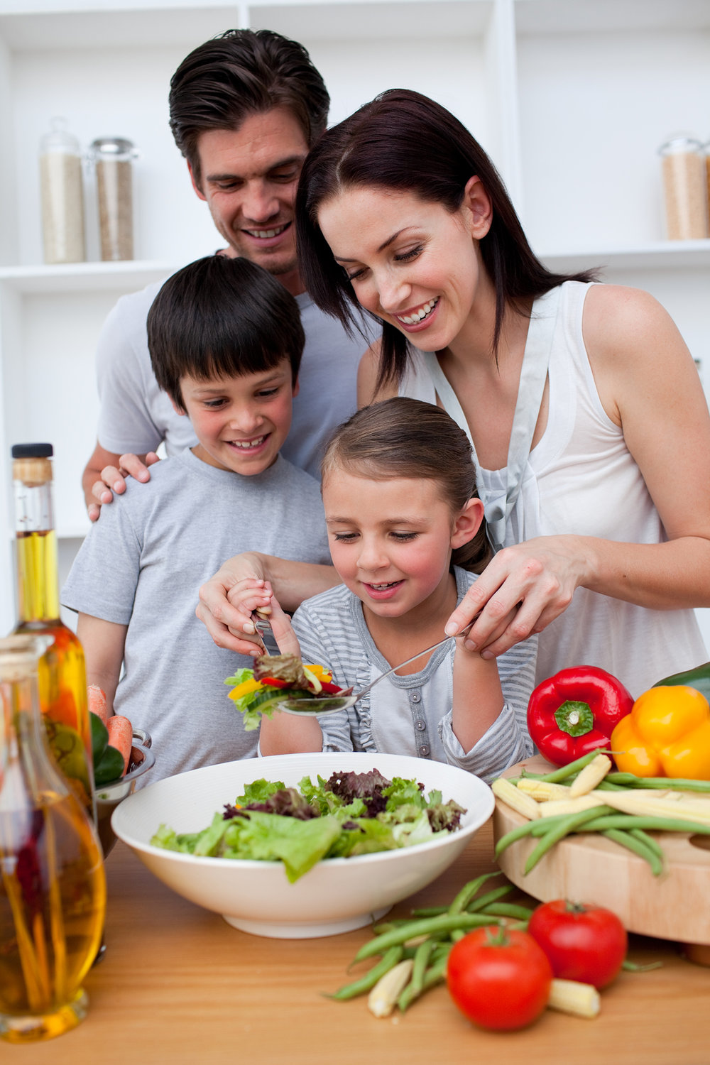 bigstock-Happy-Family-Cooking-Together-6460207.jpg