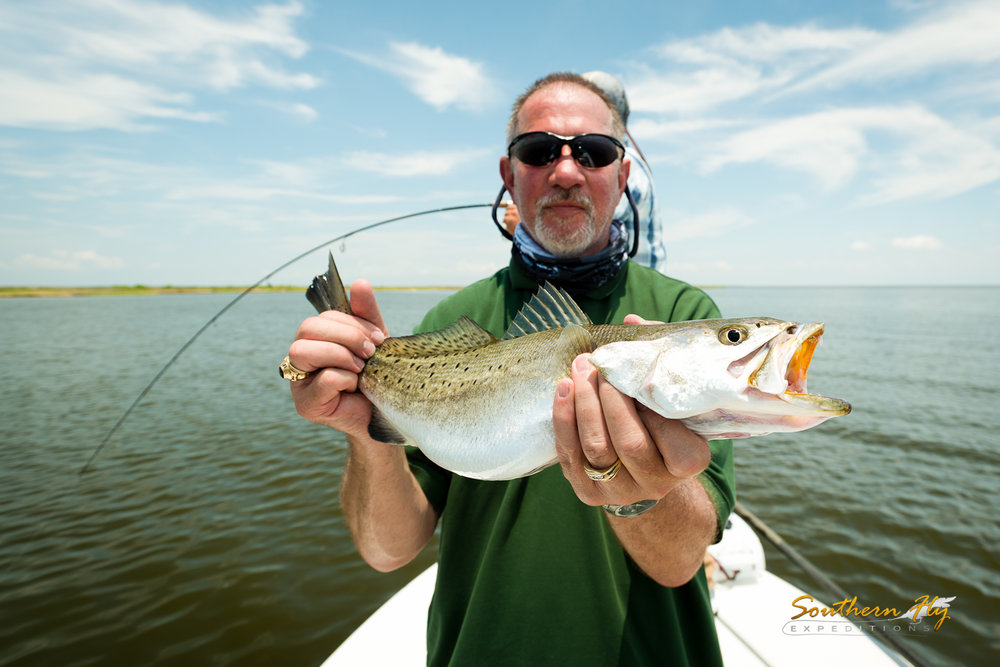 Spin Casting for Reds reeled in a Trout Best Guide in Louisiana Fly Fishing