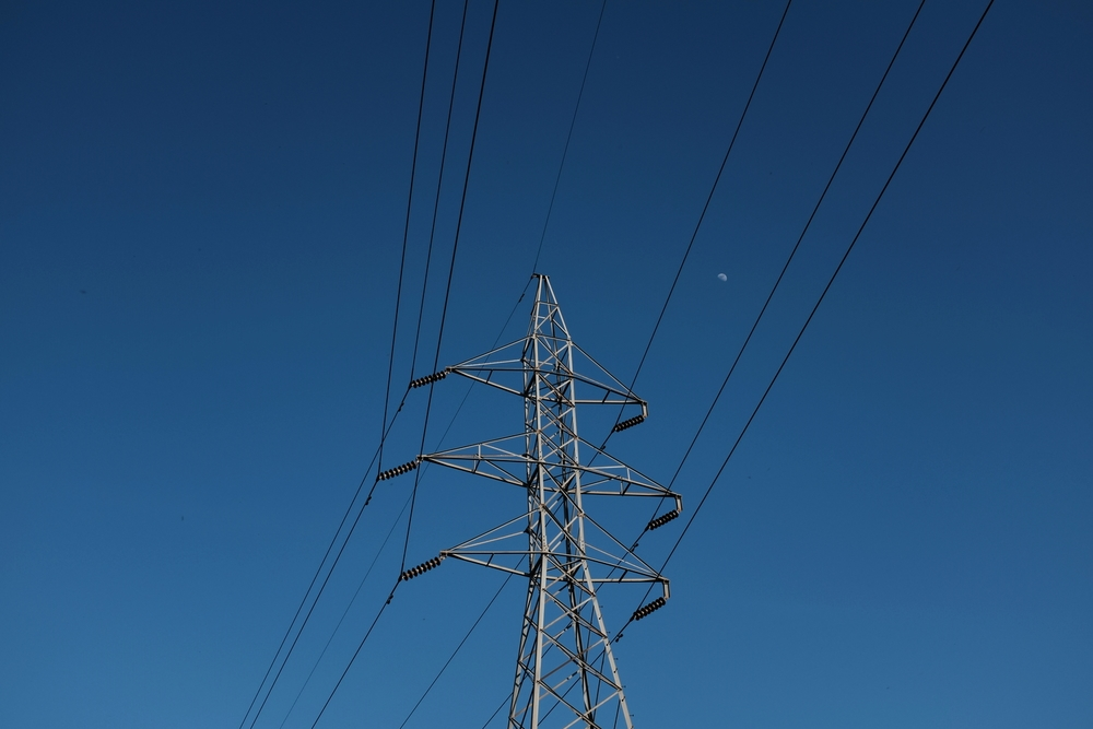 Power lines containing a small moon. Hidden Falls Park.