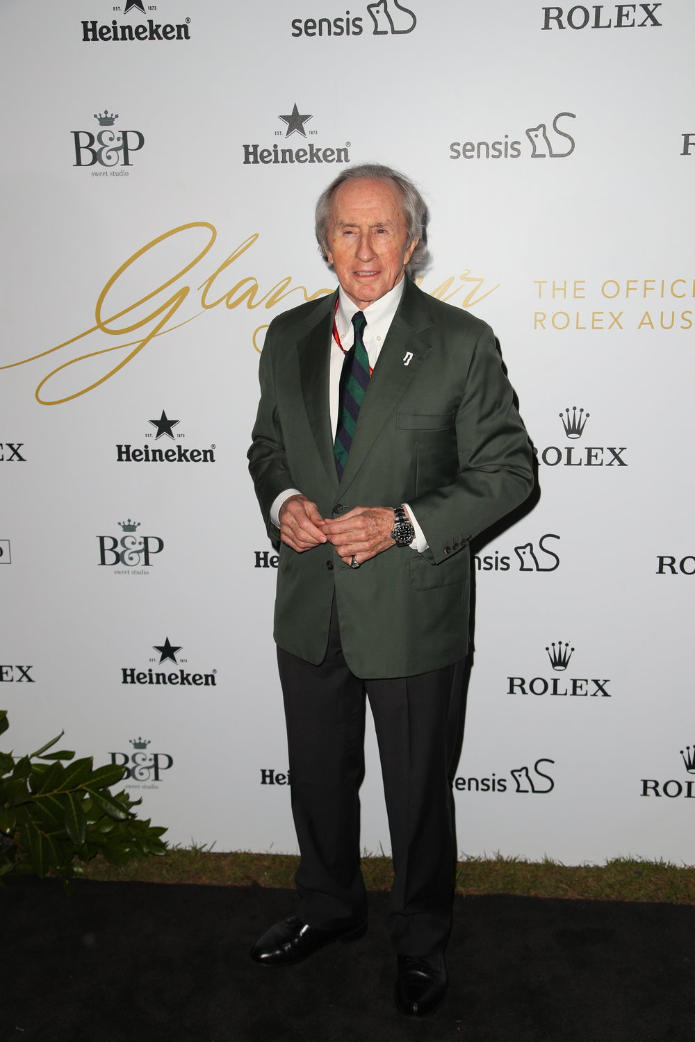 Sir Jackie Stewart on the media wall with Burch & Purchese branding at the 'Glamour on the Grid' launch party for the 2017 Australian Grand Prix at Albert Park.