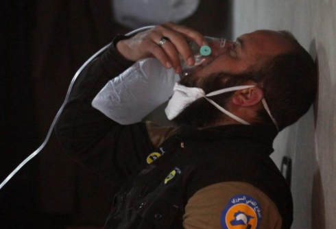 Reuters: A civil defense member breathes through an oxygen mask, after chemical attack in the town of Khan Sheykhoun in Idlib, Syria April 4, 2017.